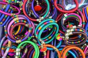 pile of women s assorted colored bangles